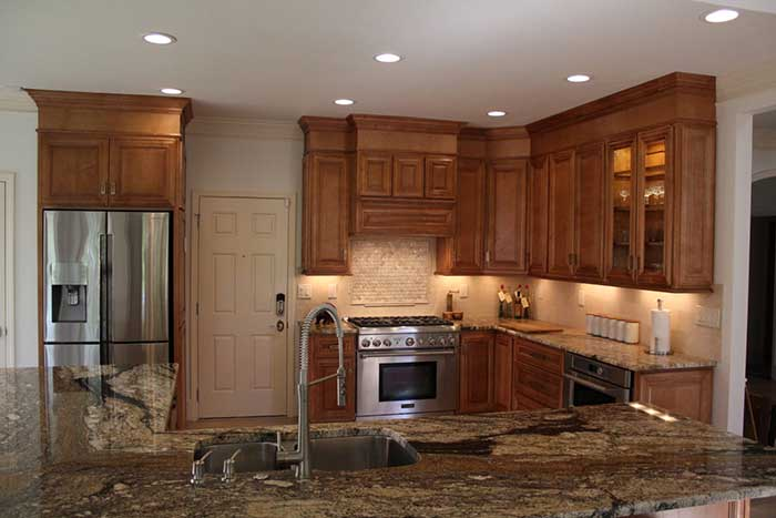 Wooden furniture in kitchen by John Rogers Renovations